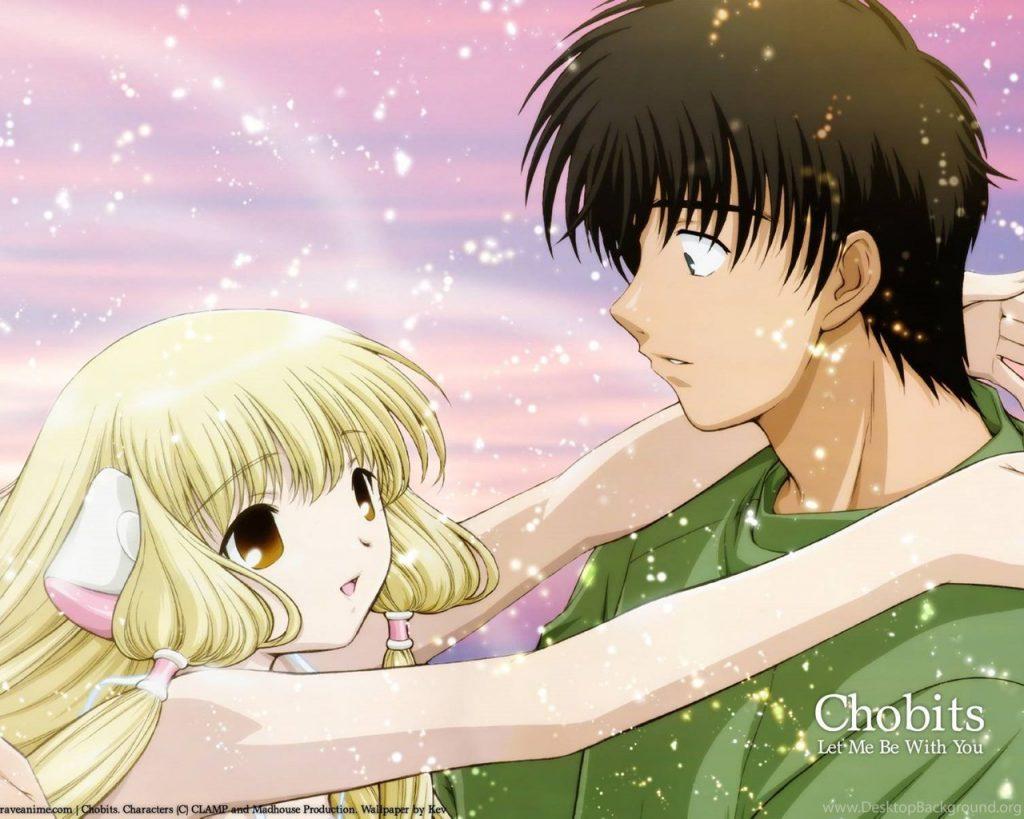 Uma garota loira com cabelos longos e de vestido, fazendo gestos de abraço, para um jovem que a olha surpreso com a sua atitude. Ele está usando um moletom verde.